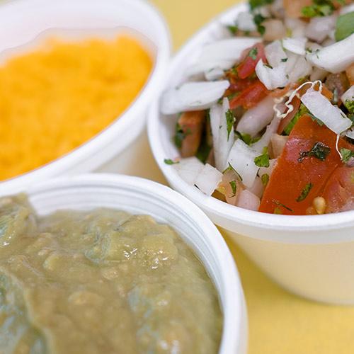 A few sauces shredded cheese, pico de gallo, and guacamole
